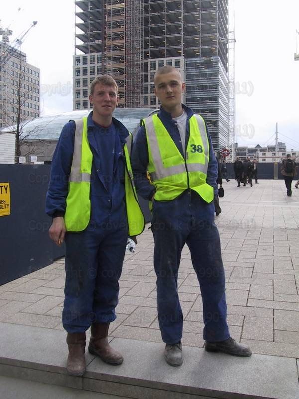 Lads wearing coveralls at Canary Wharf