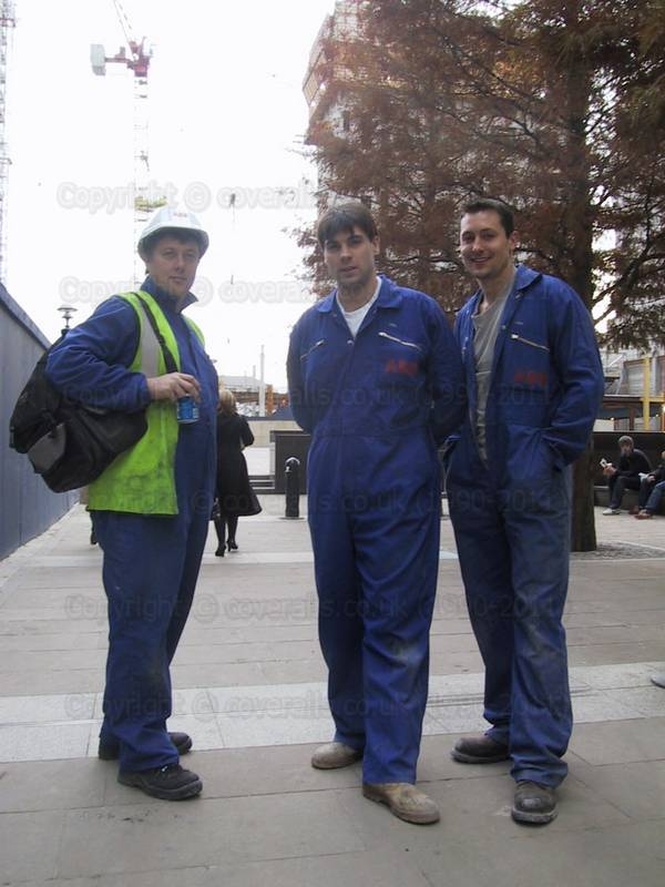 Plumbers wearing blue coveralls at Canary Wharf 1