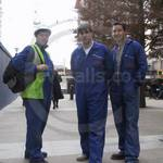 Plumbers in blue coveralls at Canary Wharf