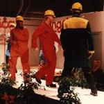 Red Overalls, yellow hardhat