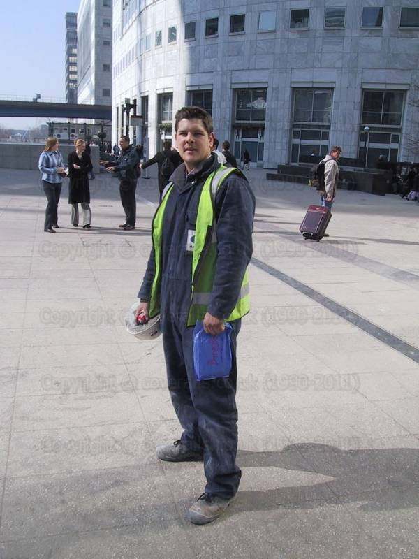 Young guy in blue coveralls at Canary Wharf 4
