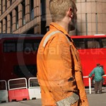 Blond Guy Wearing Old Worn Orange Boiler Suit