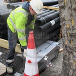 Young lad repairing cabling wearing navy Iona Bizweld coveralls by Portwest