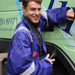 Boy Smiling wearing baggy blue hi-vis boilersuit lord mayors show 2011