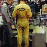 Guy wearing yellow camel branded jumpsuit at CeBit