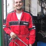Car Mechanic wearing a Ferodo overall