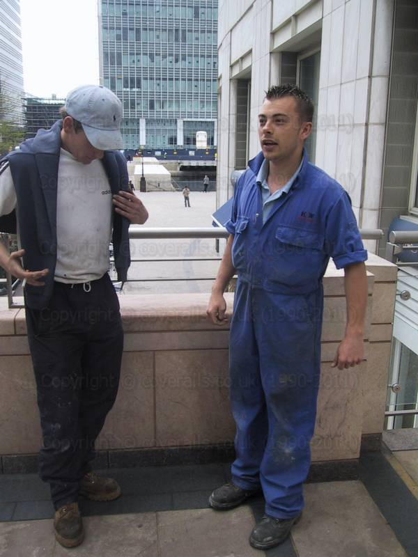 Guy wearing blue coveralls at Canary Wharf 34