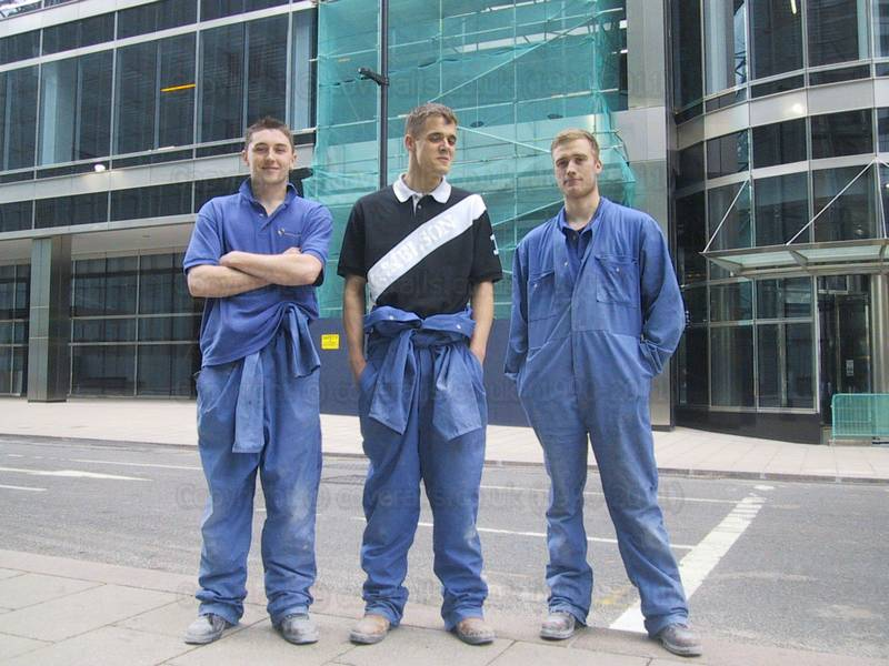 Picture of construction workers wearing blue overalls