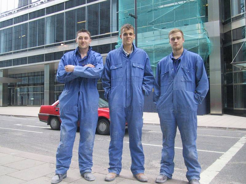 Picture of Three young guys wearing blue overalls