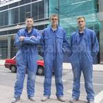 Three young guys wearing blue overalls