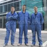 Three young guys wearing blue overalls 45