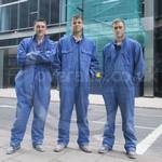 Three young guys wearing blue overalls 48