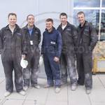 construction workers at Canary Wharf wearing brown overalls