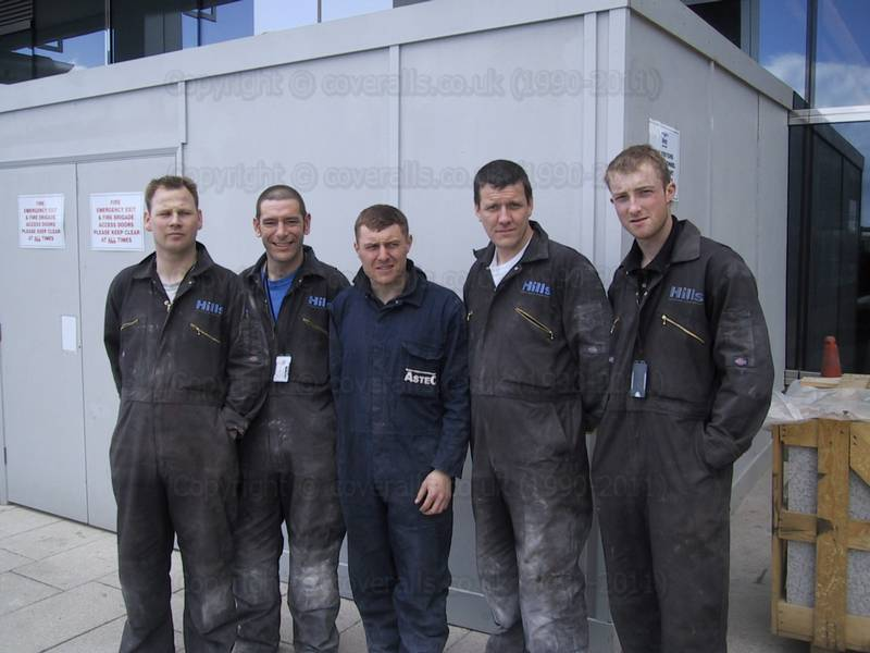 construction workers at Canary Wharf wearing brown overalls 56