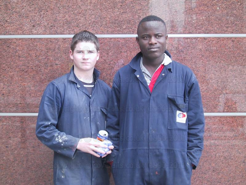 Picture of Two young lads wearing blue coveralls at Canary Wharf
