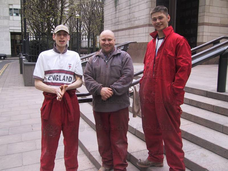 Young construction workers wearing red overalls at Canary Wharf 25
