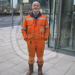 construction worker wearing orange hi-vis overalls 3