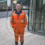 construction worker wearing orange hi-vis overalls 4
