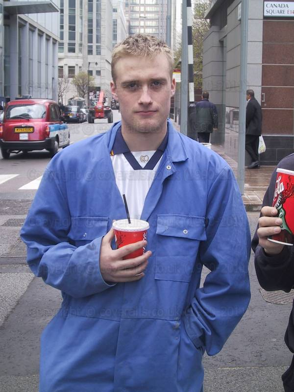 Picture of Young guy wearing blue overalls