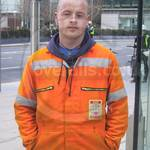 construction worker wearing orange hi-vis overalls 5