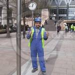 construction worker at Canary Wharf wearing blue overalls