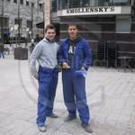 construction workers at Canary Wharf wearing blue overalls doing some serious camera posing