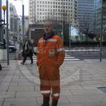 construction worker wearing orange hi-vis overalls