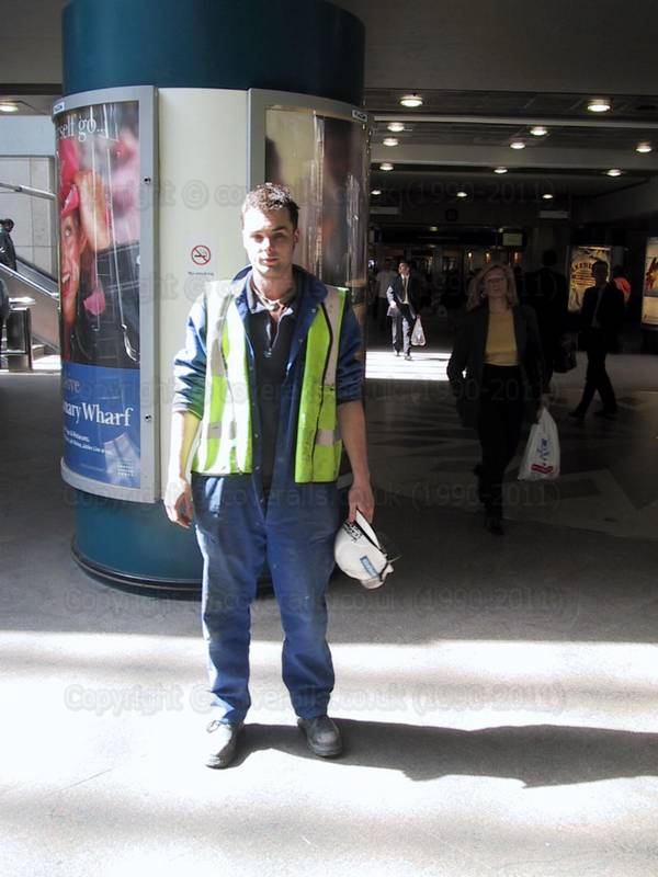 Young guy weaning blue coveralls in Canary Wharf 3