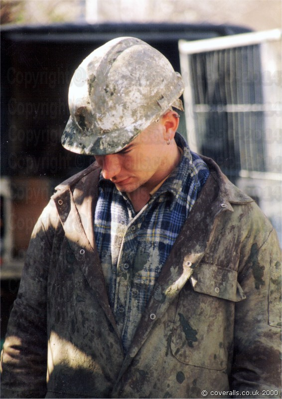 Craig drilling, wearing a brown muddy coverall 1