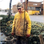 Craig drilling, wearing a brown muddy wet coverall