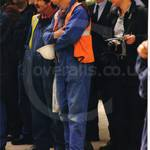 builders in coveralls at Canary Wharf