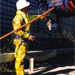Drain sewage engineer in yellow pvc coveralls