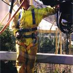 Drain sewage engineer in yellow pvc coveralls 3