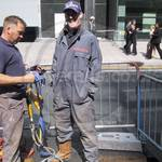 Drain service engineer wearing grey coveralls