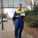 Young Motor Mechanic wearing yellow/blue overalls