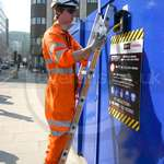 More Pictures of Electrician Sam wearing his orange hi-vis Arco Rail spec GO/RT Coverall