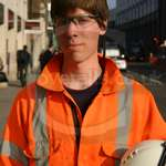 Electrician wearing his orange hi-vis Arco rail spec GO/RT coverall