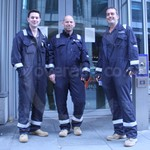 Electricity workers wearing blue Hi-vis coveralls