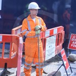 Electricity workers wearing Orange Hi-vis coveralls