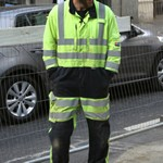 Electricity workmen wearing ProGarm Hi-vis Yellow/Grey 6458 Linesman Arc Coverall