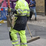 Workman repairing electricity supply wearing hi-vis Yellow/Blue arc-flash coveralls