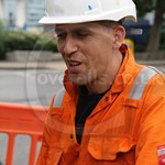 Electricity Workman Wearing Portwest Bizweld Hi-Vis Orange Coveralls