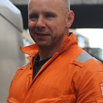 Electricity Workmen Wearing Portwest Hi-vis Orange Bizflane Coveralls
