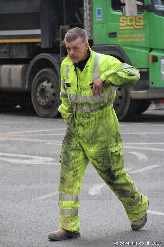 Electricity Power worker wearing a parachutist style double full length zip hi-vis yellow Jumpsuit coverall. Electricity Power Workman wearing Hi-vis Yellow Jumpsuit 5