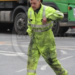 Electricity Power Workman wearing Hi-vis Yellow Jumpsuit
