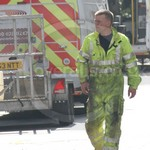 Electricity Power worker wearing a parachutist style double full length zip hi-vis yellow Jumpsuit coverall