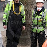 Two Workmen just about to go underground to repair cabling destroyed after the in fire in the Kingsway tunnel, London