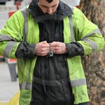 Electricity Power Workmen in Street wearing black coveralls