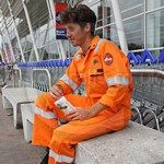 Handsome Smiling Engineer Guy Wearing Orange Roots Flamebuster Coveralls