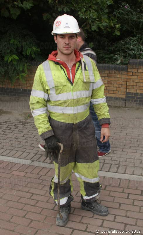Picture of Engineer Wearing a Yellow Grey Hi-vis Phoenix Flame Resistant Coverall
